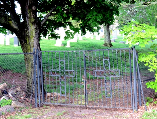 A cemetery fence and gate